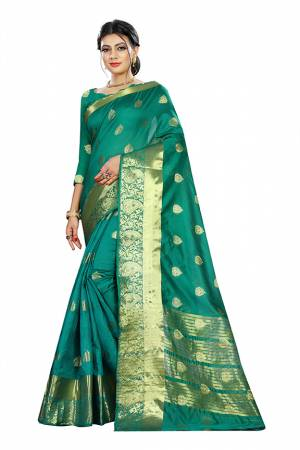 Beat This Heat This Summer Wearing This Pretty Attractive Sea Green Colored Saree. This Saree And Blouse Are Fabricated On Cotton Silk Beautified With Weave Butti All Over. Also It Is Light In Weight And Easy To Carry All Day Long.