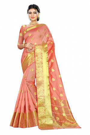 Beat This Heat This Summer Wearing This Pretty Attractive Peach Colored Saree. This Saree And Blouse Are Fabricated On Cotton Silk Beautified With Weave Butti All Over. Also It Is Light In Weight And Easy To Carry All Day Long.