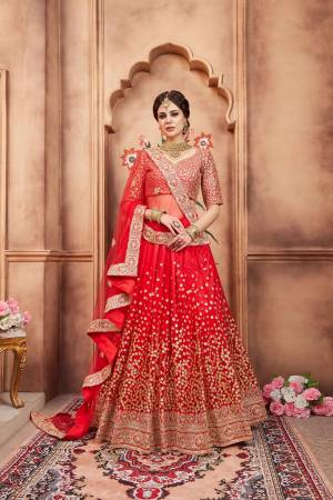 Adorn The Pretty Angelic Look In This Heavy Designer Red Colored Lehenga Choli. Its Blouse Is Fabricated On Art Silk Paired With Net Fabricated Dupatta. Its Lovely Intricate Embroidery Will Earn You Lots Of Compliments From Onlookers.