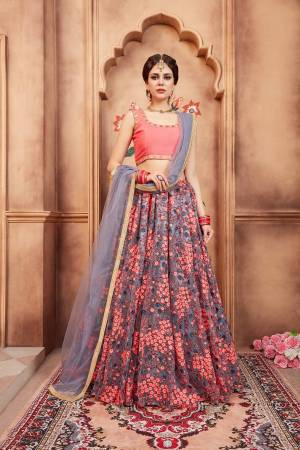 Go Colorful With This Designer Lehenga Choli In Dark Peach Colored Blouse Paired With Grey Colored Lehenga And Dupatta. Its Blouse Is Fabricated On art Silk Paired With Net Fabricated Embroidered Lehenga And Net Dupatta.