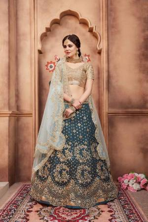 Grab This Very Pretty Heavy Designer Lehenga Choli In Golden Colored Blouse Paired With Teal Blue Colored Lehenga And Aqua Blue Colored Dupatta. Its Blouse Are Lehenga Are Fabricated On Art Silk Paired With Net Fabricated Dupatta.