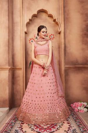 Look Pretty In this Designer Baby Pink Colored Lehenga Choli. Its Pretty Blouse And Lehenga Are Fabricated On Georgette Paired With Net Fabricated Dupatta. It Is Beautified With Mirror And Stone Work.