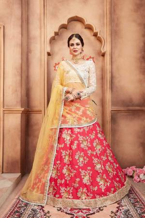 Colors Add Beauty To Any Garment And Ofcourse To Your Look. Grab This Designer Lehenga Choli In White Colored Blouse Paired With Red Colored Lehenga And Contrasting Yellow Colored Dupatta. Its Blouse And Dupatta are Net Fabricated Paired With Art Silk Fabricated Lehenga.