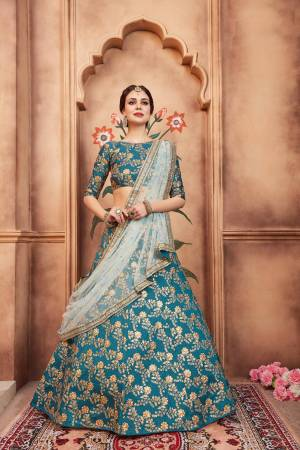 Go With The Lovely Shades Of Blue With This Heavy Designer Lehenga Choli In Blue Color Paired With Aqua Blue Colored Dupatta. Its Blouse And Lehenga Are Fabricated On Art Silk Paired With Net Fabricated Dupatta. Buy Now.