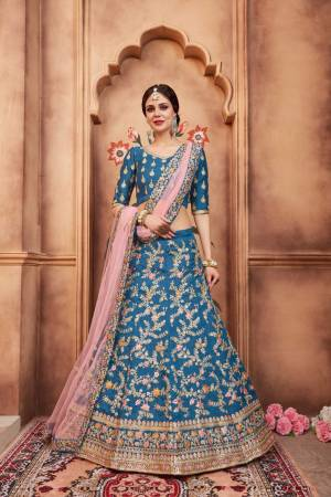 Add This Lovely Designer Lehenga Choli To Your Wardrobe In Blue Color Paired With Pretty Pink Colored Dupatta. This Lehenga Choli Is Silk Based Paired With Net Fabricated Dupatta. Buy This Now.