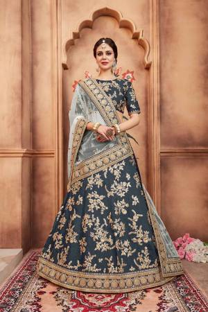 Here Is A New Colored Pallete Heavy Designer lehenga Choli In Dark Grey Color Paired With Baby Blue Colored Dupatta. This Embroidered Lehenga Choli Is Fabricated On Art Silk Paired With Net Fabricated Dupatta. Buy This Now.