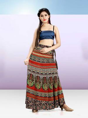 Grab This Beautiful Wrap Around Skirt In Multi Color For Your Casuals Or Semi-Casuals. This Skirt Is Fabricated On Rayon Beautified With Prints All Over.