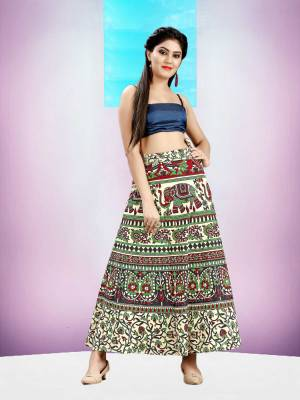 Grab This Beautiful Wrap Around Skirt In Multi Color For Your Casuals Or Semi-Casuals. This Skirt Is Fabricated On Cotton Beautified With Prints All Over.