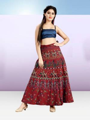 Grab This Beautiful Wrap Around Skirt In Maroon Color For Your Casuals Or Semi-Casuals. This Skirt Is Fabricated On Cotton Beautified With Prints All Over.