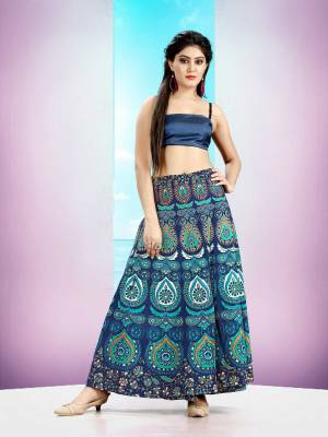 Grab This Beautiful Wrap Around Skirt In Blue Color For Your Casuals Or Semi-Casuals. This Skirt Is Fabricated On Cotton Beautified With Prints All Over.