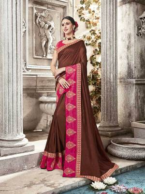 Grab This Designer Brown Colored Saree Paired With Contrasting Rani Pink Colored Blouse. This Saree And Blouse Are Silk Based Beautified With Attractive Embroidery. Buy Now.