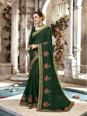 Here Is A Beautiful Designer Saree In Dark Green Color Paired With Dark Green Colored Blouse. This Saree And Blouse Are Silk Beautified With Contrasting Embroidery Giving It An Attractive Look.