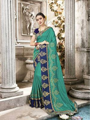 Celebrate This Festive Season Wearing This Designer Saree In Sea Green Color Paired With Contrasting Royal Blue Colored Blouse. It Is Rich Silk Based Which Earn You Lots Of Compliments From Onlookers.
