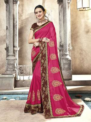 Shine Bright Wearing This Designer Saree In Dark Pink Color Paired With Brown Colored Blouse. This Saree And Blouse Are Silk Based Beautified with Embroidery. Buy Now.