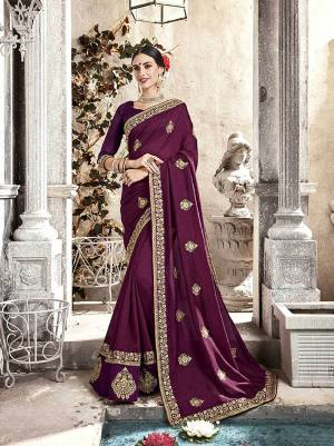 A Must Have Shade In Every Womens Wardrobe Is Here With This Designer Saree In Wine Color Paired With Wine Colored Blouse. This Saree And Blouse are Fabricated On Silk Beautified With Embroidery. Buy This Saree Now.