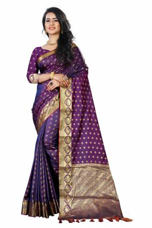 Add This Beautiful Silk Based Saree To Your Wardrobe In Purple Color Paired With Purple Colored Blouse. It Is Beautified With Attractive Butti Weave Over The Saree And Blouse. Buy Now.