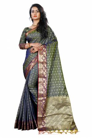 Add This Beautiful Silk Based Saree To Your Wardrobe In Grey Color Paired With Grey Colored Blouse. It Is Beautified With Attractive Butti Weave Over The Saree And Blouse. Buy Now.