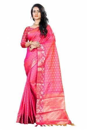 Add This Beautiful Silk Based Saree To Your Wardrobe In Fuschia Pink Color Paired With Fuschia Pink Colored Blouse. It Is Beautified With Attractive Butti Weave Over The Saree And Blouse. Buy Now.