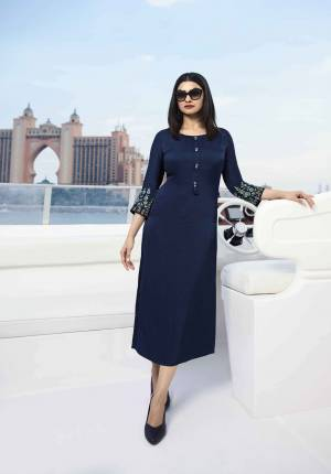 Enhance Your Personality Wearing This Designer Readymade Kurti In Navy Blue Color Fabricated On Satin Silk Beautified With Contrasting Thread And Stone Work. Buy Now.