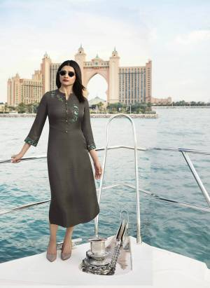 Flaunt Your Rich And Elegant Taste Wearing This Designer Readymade Kurti In Grey Color Fabricated On Satin Silk Beautified With Contrasting Thread Embroidery And Stone Work. It Is Light Weight And Easy To Carry All Day Long.