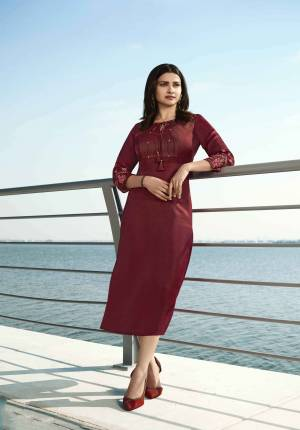 Grab This Pretty Readymade Designer Kurti In Maroon Color Fabricated On Satin Silk. This Straight Kurti Is Beautified With Embroidery With yoke And Sleeves.