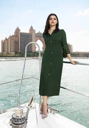 Simple And Elegant Patterned Readymade Kurti Is Here In Dark Green Color Fabricated On Satin Silk Beautified With Embroidered Butti Over The Bell Sleeves. Buy Now.