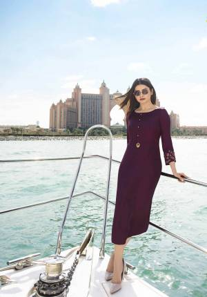 A Must Have Shade In Every Womens Wardrobe Is Here With This Designer Readymade Straight Cut Kurti In Wine Color. This Pretty Kurti Is Fabricated Satin Silk Beautified With Embroidered Sleeves And Buttons. Buy Now.