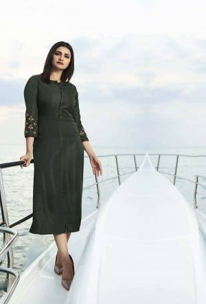 Grab This Pretty Readymade Designer Kurti In Forest Green Color Fabricated On Satin Silk. This Straight Kurti Is Beautified With Embroidery With yoke And Sleeves.