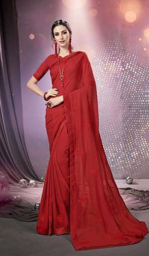 Here Is A Very Pretty Designer Saree Fabricated On Chiffon Paired With Art Silk Fabricated Blouse. It Is Beautified With Tone To Tone Thread Embroidery And Stone Work Which Gives A Rich Look Overall. Buy This Saree Now.