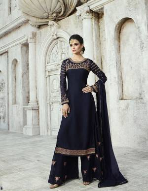 Enhance Your Personality Wearing This Designer Straight Suit In Navy Blue Color Paired With Navy Blue Colored Bottom And Dupatta. Its Top Is Fabricated On Satin Georgette Paired With Georgette Bottom And Chiffon Dupatta. Its Top And Bottom Are Beautified With Attractive Embroidery.