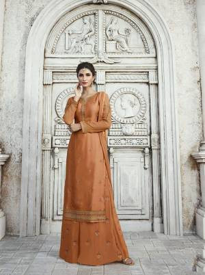 New Shade Is Here To Add Into Your Wardrobe With This Designer Straight Plazzo Suit In Light Brown Color. Its Top IS Fabricated On Satin Georgette Paired With Georgette Bottom And Chiffon Fabricated Dupatta, All Its Fabrics Are Light Weight And Easy To Carry All Day Long.