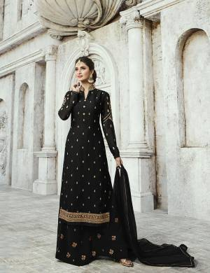 For A Bold And Beautiful Look, Grab This Designer Straight Cut Plaazo Suit In Black Color. Its Top Is Fabricated On Satin Georgette Paired With Georgette Bottom And Chiffon Fabricated Dupatta. Buy This Semi-Stitched Suit Now.