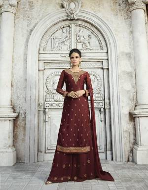 Here Is A Royal Looking Designer Plazzo Suit In Maroon Color. Its Top Is Fabricated On Satin Georgette Paired With Georgette Bottom And Chiffon Fabricated Dupatta. Its Top And Bottom Are Beautified With Attractive Embroidery. Buy Now.