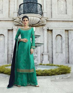 Grab This Beautiful Designer Straight Suit In Sea Green Color Paired With Sea Green Colored Bottom And Contrasting Navy Blue Colored Dupatta.