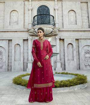 Shine Bright In This Designer Straight Suit In Dark Pink Color Paired With Dark Pink Colored Bottom And Dupatta. Its Top Is Fabricated On Satin Georgette Paired With Georgette Bottom And Chiffon Fabricated Dupatta. It Is Light Weight And Easy To Carry Throughout The Gala.
