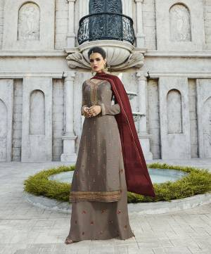 New Shade Is Here To Add Into Your Wardrobe With This Designer Straight Plazzo Suit In Sand Grey Colored Top And Bottom Paired With Contrasting Maroon Colored Dupatta. Its Top IS Fabricated On Satin Georgette Paired With Georgette Bottom And Chiffon Fabricated Dupatta, All Its Fabrics Are Light Weight And Easy To Carry All Day Long.