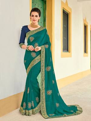 Get this amazing saree and look pretty like never before. wearing this Sea green color silk pattern saree. Ideal for party, festive & social gatherings. this gorgeous saree featuring a beautiful mix of designs. Its attractive color and designer heavy embroidered design, Flower embroidered butta design, stone design, beautiful floral design work over the attire & contrast hemline adds to the look. Comes along with a contrast unstitched blouse.