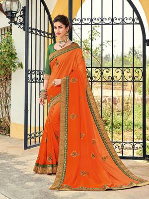 Flaunt your gorgeous look wearing this orange color two tone silk shaded saree. Ideal for party, festive & social gatherings. this gorgeous saree featuring a beautiful mix of designs. Its attractive color and designer heavy embroidered design, Flower embroidered butta design, stone design, beautiful floral design work over the attire & contrast hemline adds to the look. Comes along with a contrast unstitched blouse.