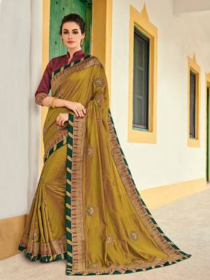 The fabulous pattern makes this saree a classy number to be included in your wardrobe. Pear green color two tone silk saree. Ideal for party, festive & social gatherings. this gorgeous saree featuring a beautiful mix of designs. Its attractive color and designer heavy embroidered design, Flower embroidered butta design, stone design, beautiful floral design work over the attire & contrast hemline adds to the look. Comes along with a contrast unstitched blouse.