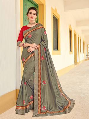 You Look elegant and stylish this festive season by draping this grey color two tone silk saree. Ideal for party, festive & social gatherings. this gorgeous saree featuring a beautiful mix of designs. Its attractive color and designer heavy embroidered design, Flower embroidered butta design, stone design, beautiful floral design work over the attire & contrast hemline adds to the look. Comes along with a contrast unstitched blouse.
