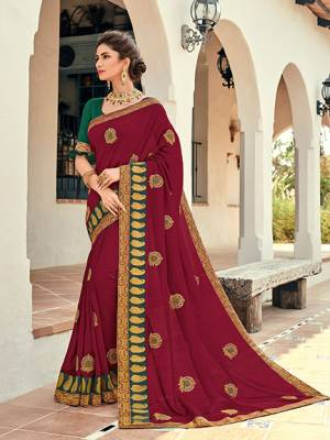 Wear this Maroon color silk pattern saree. Ideal for party, festive & social gatherings. this gorgeous saree featuring a beautiful mix of designs. Its attractive color and designer heavy embroidered design, Flower embroidered butta design, stone design, beautiful floral design work over the attire & contrast hemline adds to the look. Comes along with a contrast unstitched blouse.