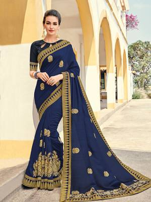 marvelously charming is what you will look at the next wedding gala wearing this beautiful Navy Blue color silk pattern saree. Ideal for party, festive & social gatherings. this gorgeous saree featuring a beautiful mix of designs. Its attractive color and designer heavy embroidered design, Flower embroidered butta design, stone design, beautiful floral design work over the attire & contrast hemline adds to the look. Comes along with a contrast unstitched blouse.