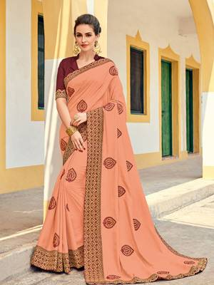 Bring out the best in you when wearing this peach color silk fabrics saree. Ideal for party, festive & social gatherings. this gorgeous saree featuring a beautiful mix of designs. Its attractive color and designer heavy embroidered design, Flower embroidered butta design, stone design, beautiful floral design work over the attire & contrast hemline adds to the look. Comes along with a contrast unstitched blouse.