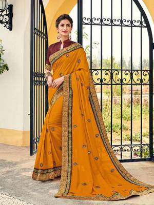 Vibrant and visually appealing, this Musturd yellow color silk pattern saree. Ideal for party, festive & social gatherings. this gorgeous saree featuring a beautiful mix of designs. Its attractive color and designer heavy embroidered design, Flower embroidered butta design, stone design, beautiful floral design work over the attire & contrast hemline adds to the look. Comes along with a contrast unstitched blouse.