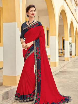 Look your ethnic best by wearing this red color silk fabrics saree. Ideal for party, festive & social gatherings. this gorgeous saree featuring a beautiful mix of designs. Its attractive color and designer heavy embroidered design, Flower embroidered butta design, stone design, beautiful floral design work over the attire & contrast hemline adds to the look. Comes along with a contrast unstitched blouse.