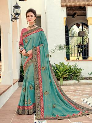Look gorgeous in this beautiful printed Sky Blue color two tone silk saree. Ideal for party, festive & social gatherings. this gorgeous saree featuring a beautiful mix of designs. Its attractive color and designer heavy embroidered design, Flower embroidered butta design, stone design, beautiful floral design work over the attire & contrast hemline adds to the look. Comes along with a contrast unstitched blouse.