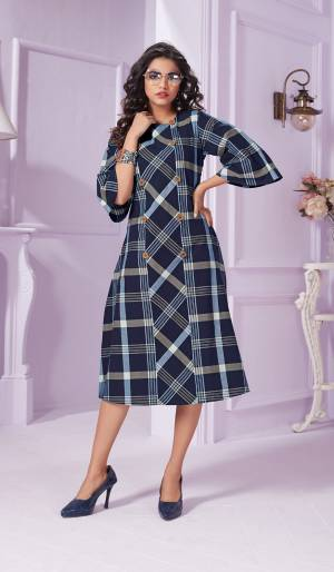 Grab This Beautiful Readymade Kurti In Blue Color Fabricated On Cotton Beautified With Bold Checks Prints All Over It. This Kurti Is Light Weight And Easy To Carry All Day Long.