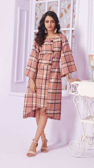 Look Pretty In This Beautiful Plaids Printed Readymade Kurti In Dusty Pink Color Fabricated On Cotton. Its Rich Color And Bold Checks Will Earn You Lots Of Compliments From Onlookers.