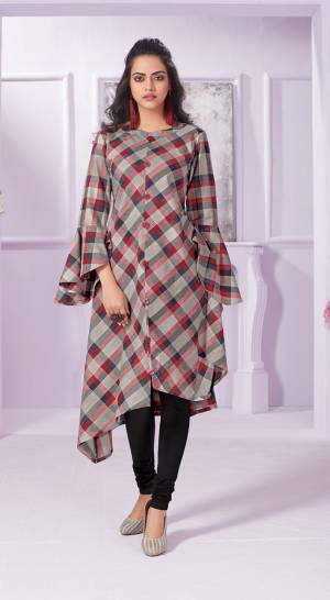 Assymetric Patterned Designer Readymade Kurti Is Here In Grey Color Fabricated On Cotton. It Is Beautified With Red And Grey Colored Checks All Over.