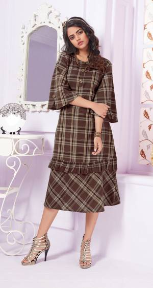 If You Are Looking Something For Your Office Wear, Than Grab This Designer Readymade Printed Kurti In Brown Color Fabricated On Cotton. This Kurti Is Cotton Based Beautified Checks Prints All Over.